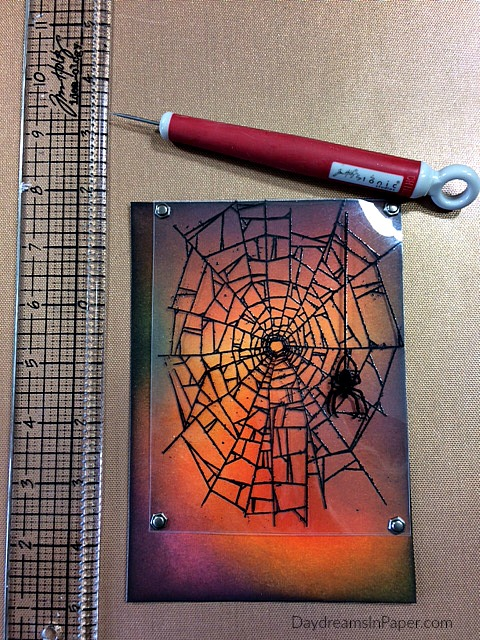 Spider Web Image Stamped on Plastic Attached with Brads