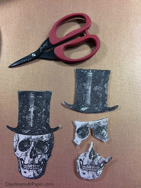 Two Skeleton Stamped Images, One Cut In Three Pieces